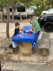 Boys playing chess while camping